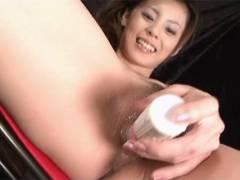 Sexy Natsumi fucks a vibrator around her snatch